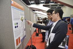 The poster session at OFC 2014.